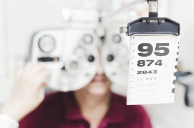 Senior man at optometrist or doctor having eye sight testing