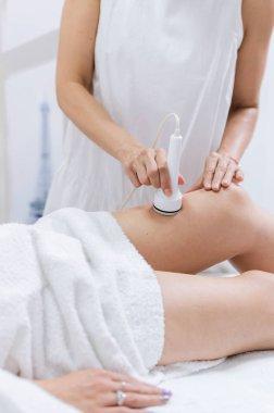 Beauty ultrasonic massage therapy at salon. Anti cellulite.