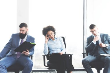 business people waiting nervously for their job interview in company