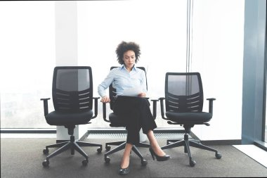 young woman waiting for her job interview in big important company
