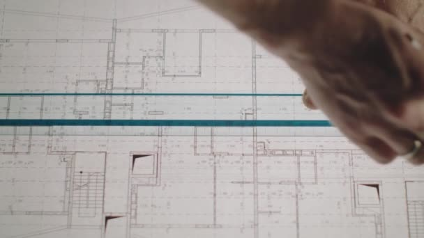 Young Architect Draws A Drawing By Paper. Close-up.