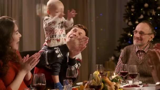 New Year Holiday. Family At Holiday Table.