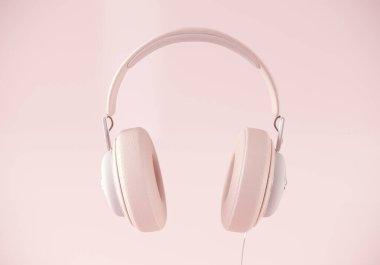 Modern headphones 3d rendering on pastel color background.