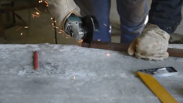 Specialist cut rectangular metal profile using angle grinder. People at work, profession and skill. Work process closeup
