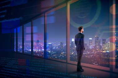 Side view of young businessman looking out of window in interior with digital interface and night city view. Research and communication concept. 3D Rendering