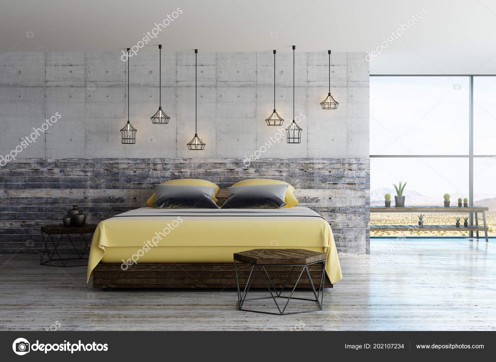 chambre loft moderne avec des détails jaunes gris sol béton