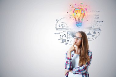business idea concept with young thinking woman in glasses with colorful 3d bulb illustration above the head and ideas sketch on white wall background