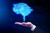 Businessman hand holding glowing digital brain. Artificial intelligence and technology concept. 3D Rendering