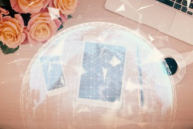 Double exposure of business theme hologram over desktop with phone. Top view. Mobile international trade connection concept.