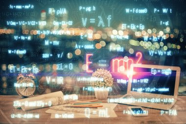 Desktop computer background and formula hologram writing. Double exposure. Education concept.
