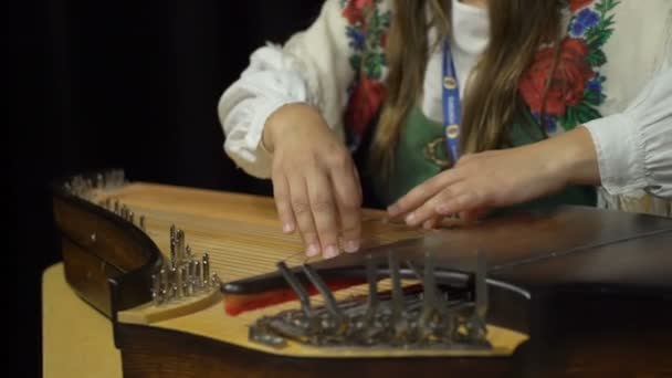 A Young Woman In Folk Costume Playing The Kantele