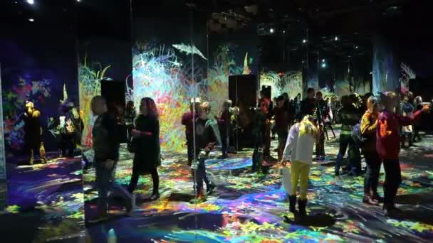 Visitors at museum enjoy the new modern digital art