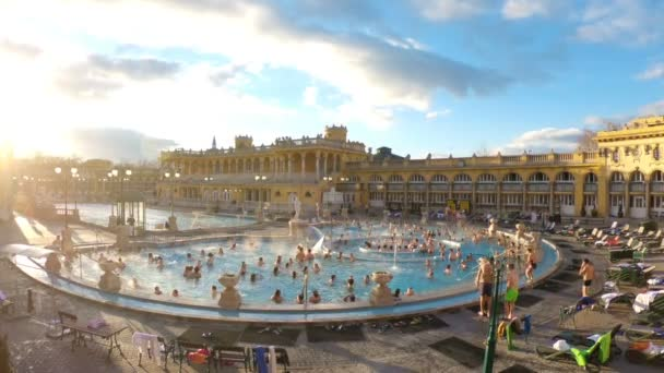 A lot of people enjoy swimming in outdoor warm thermal pool