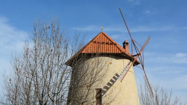 Close up view of the windmill on the background of blue sky