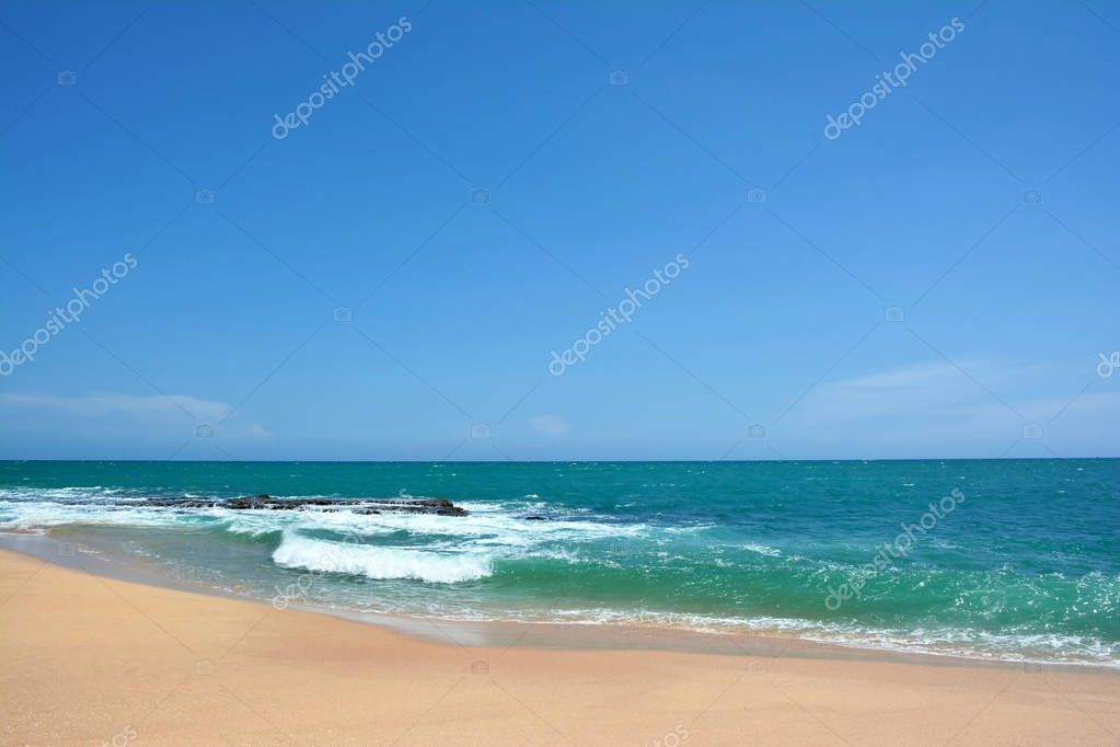 Ocean waves with white caps breaking on the shore. Indian Ocean,