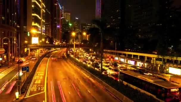 evening time lapse of illuminated enter of hong kong