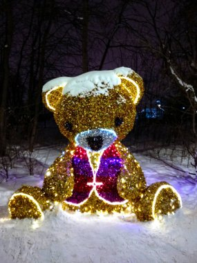 Moscow, Russia - January 13, 2019. Park Altufevo, glowing composition Photozone Bear Holiday installation