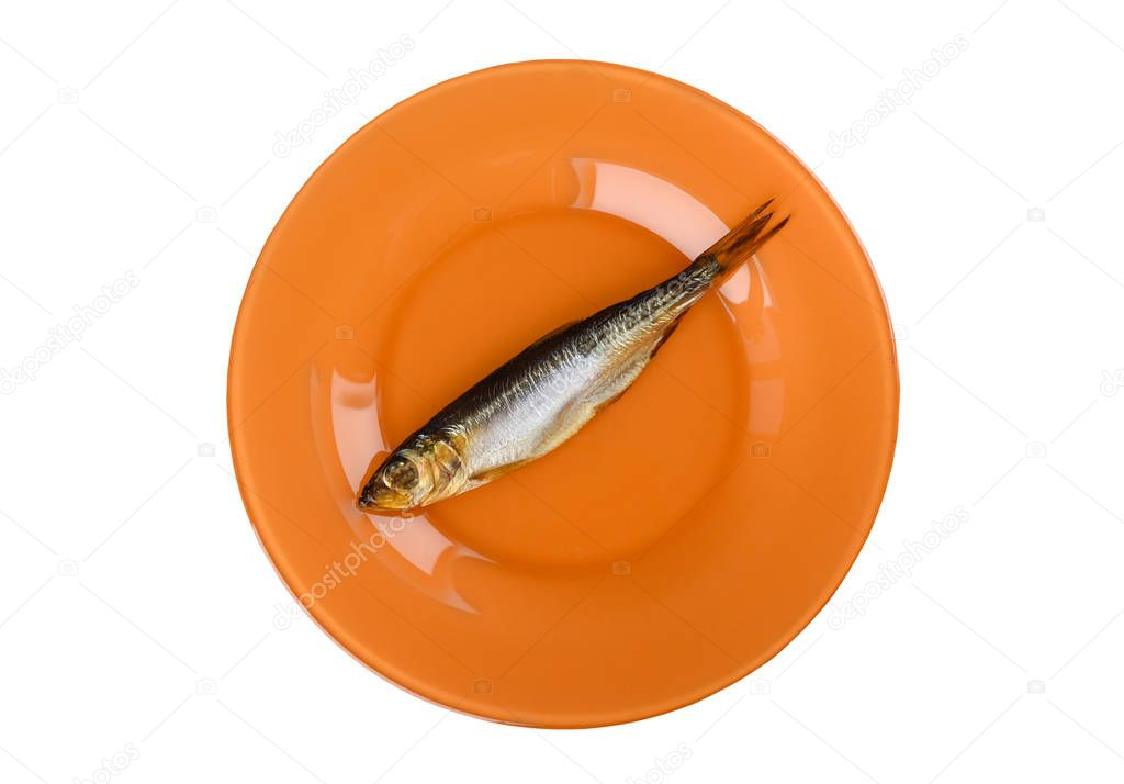 Cold smoked Baltic herring on an orange plate isolated on white background. Smoked Baltic herring smoked until golden brown.