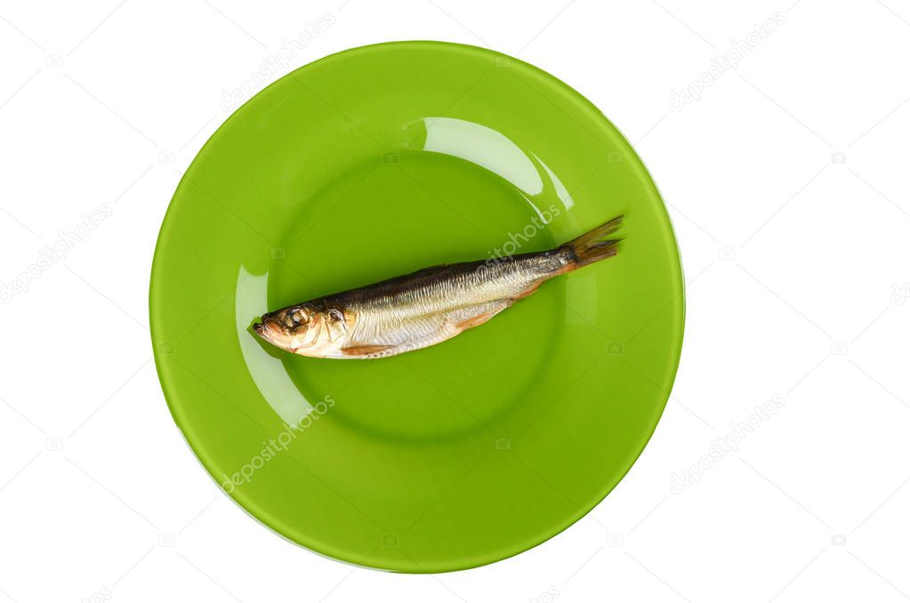 Cold smoked Baltic herring on an green plate isolated on white background.