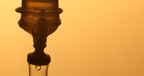 IV drips through drip chamber
