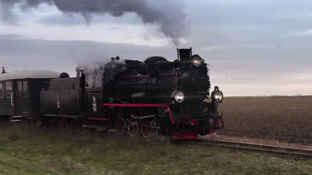 Old passangers train running on the tracks. Retro locomotive with steam engine loopable footage.