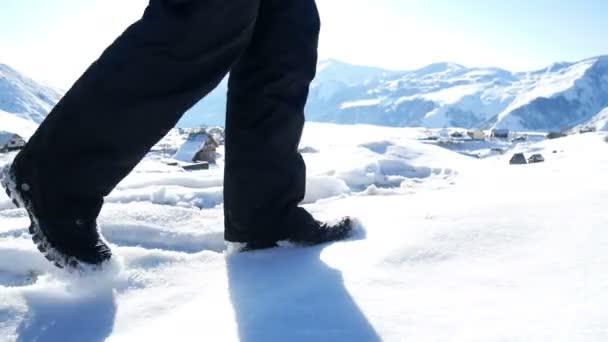 Feet walking mountains snow