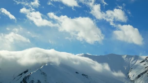 Snow mountains cloudy winter landscape nature sun timelapse
