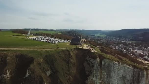 The old chapel in Etretat found on the top of the cliff the big ocean. Drone Aerial