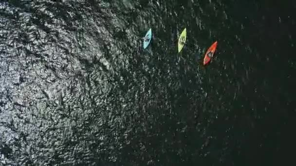 Aerial drone view of group kayak in lake.move camera view