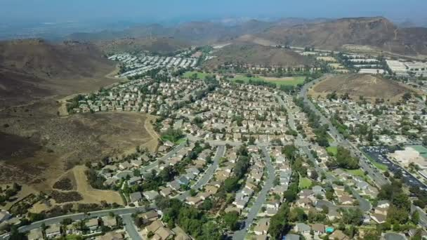 Aerial view of a suburban neighborhood whit mountain. move drone panoram. California