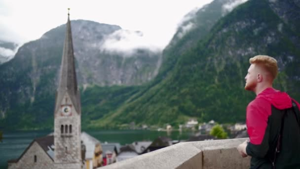 traveller man takes a photo on smartphone in Hallstatt