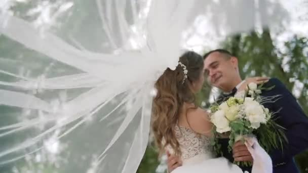 Love wedding couple kissing veil at park slow motion