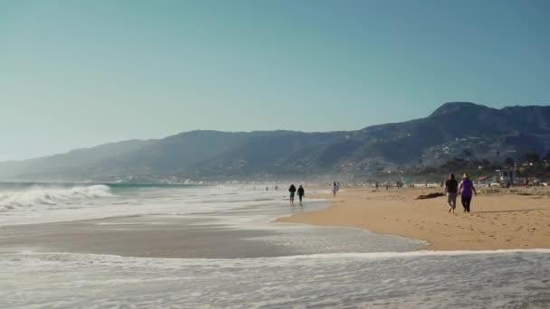 Santa Monica beach sunny day and walk people, Los Angeles
