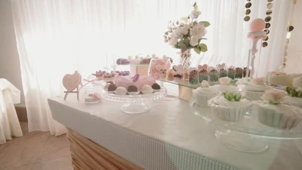 White Candy Bar Wedding, wedding pastries on sweet table candy buffet. move camera