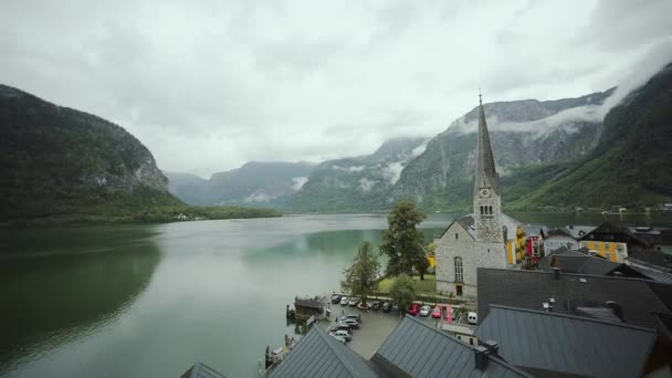 Panorami view at the lake of the Hallstatt surrounded by mountains in clouds. Austria nature. midle shot
