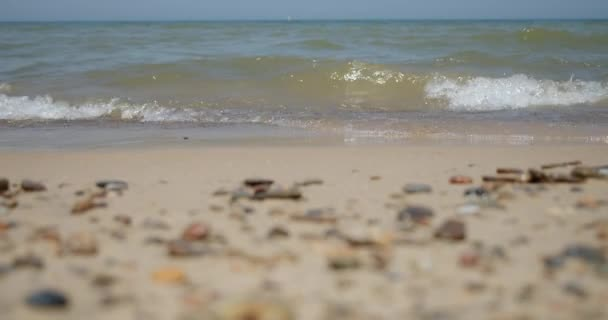 Soft wave of sea on sandy beach. whit pebble Close-up slow motion 4k