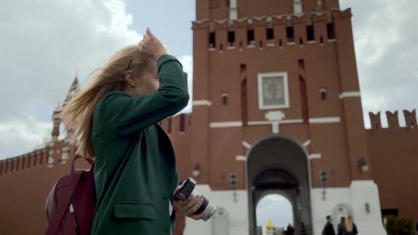 Blonde woman tourist taking pictures of Kremlin Moscow Russia Red Square
