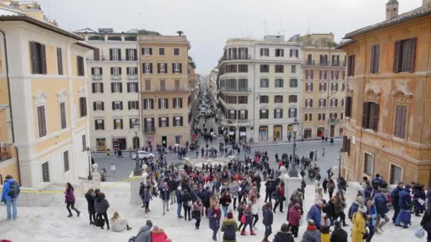 ROME - FEB 20: Tourists in coats at Piazza di Spagna, Rome, Italy, 2018