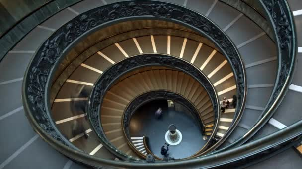 ROME, ITALY - JUNE 9 2018: Time lapse of the modern Bramante spiral stairs of the Vatican Museums, designed by Giuseppe Momo, Rome, Italy. People are walking downstairs.