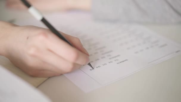 Close up of filling in a blank with multiple choice quiz