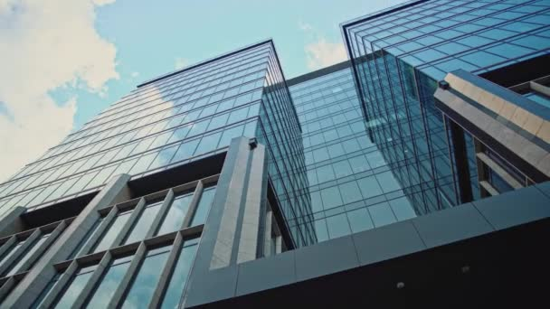 Gimbal pan shot of glass modern business center in a big city