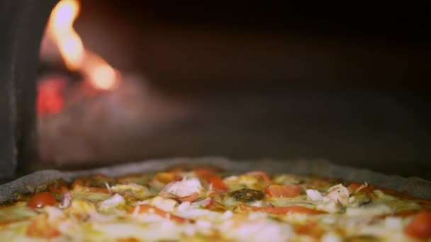 Handheld macro shot of fresh seafood pizza baked in the oven
