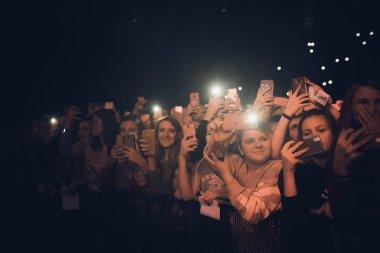 MINSK, BELARUS - 20 SEPTEMBER, 2018: Crowd at concert - retro style photo