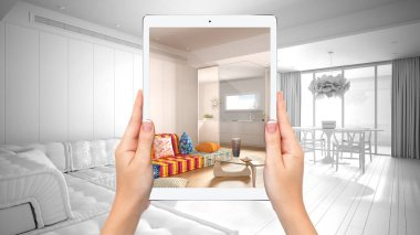 Hands holding tablet showing modern colored living room, total blank project background, augmented reality concept, application to simulate furniture and interior design products