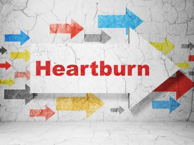 Medicine concept: arrow with Heartburn on grunge wall background