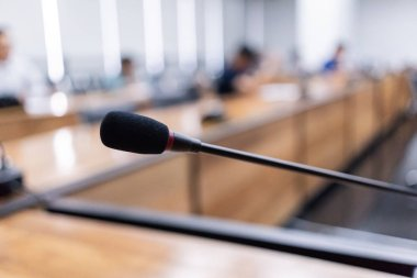 Microphone over the blurred business forum or Conference Training Learning Room Concept, Blurred background