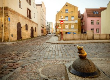 A close-up of the sculpture of the Mouse with large ears (sculptors S.Plotnikov and S.Yurkus) performing desires on the cobbled street of the Old Town of Klaipeda, Lithuania