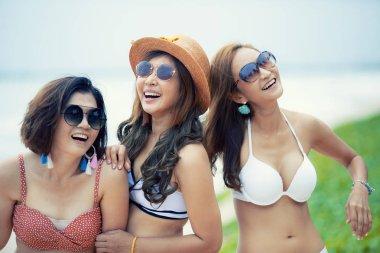 group of cheerful asian younger woman  wearing beach bikini laug