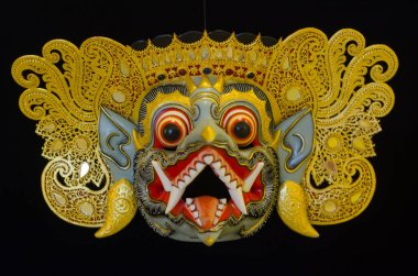 Traditional Balinese mask on a black background.
