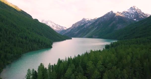 Flight over the mountain lake